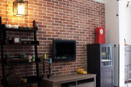 文化石电视背景墙实景图,粗糙中也有简约大气之美
