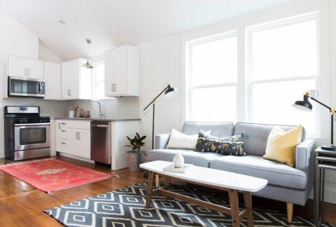 客厅蓝色沙发北欧风格装潢图片