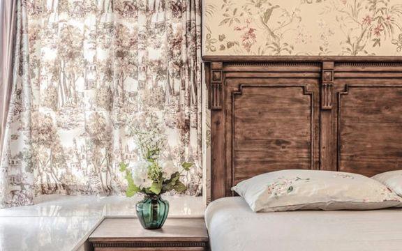 卧室咖啡色窗帘美式风格装饰效果图