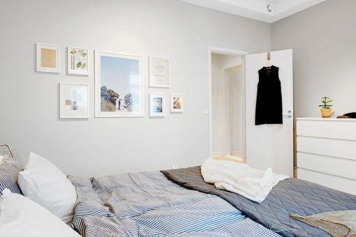 卧室白色照片墙现代简约风格装修效果图