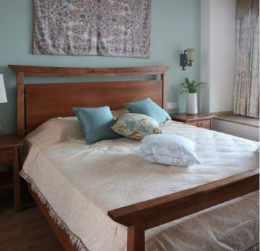 卧室咖啡色床田园风格装饰图片